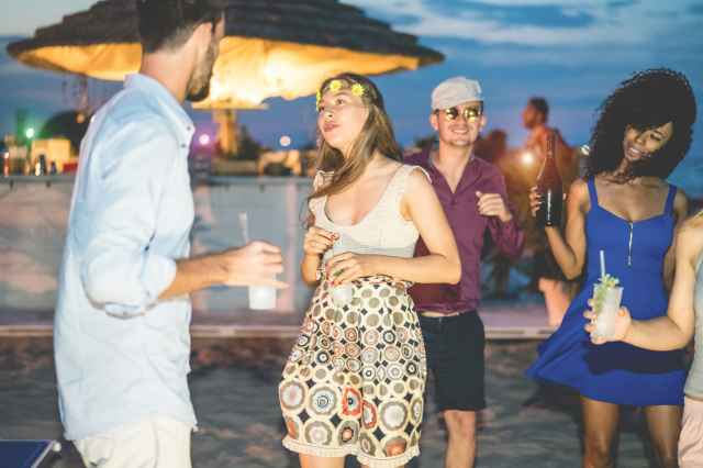 image: adults dancing on beach